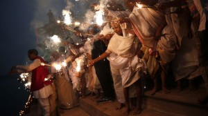 Widows, who have been abandoned by their families, light sparklers after offering prayers on the banks of the river Yamuna as part of Diwali celebrations in Vrindavan