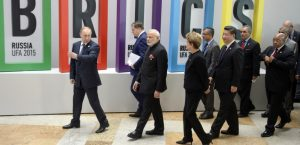Russia's President Vladimir Putin (L), Indian Prime Minister Narendra Modi (3rd L), Brazil's President Dilma Rousseff (4th L), China's President Xi Jinping (6th L) and South Africa's President Jacob Zuma (R) walk after a welcome ceremony in Ufa on July 9, 2015 at the start of the 7th BRICS summit. Leaders of the BRICS (Brazil, Russia, India, China and South Africa) group of emerging powers gathered in Ufa on Thursday to discuss regional and global issues, including the Syria conflict, threat of the Islamic State group, the situation in Greece and Iran's nuclear programme. AFP PHOTO / ALEXANDER NEMENOV