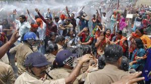 Supporters of Bharatiya Janata Party (BJP) shout slogans as police use a water cannon to stop them from moving towards the office of Akhilesh Yadav, the chief minister of Uttar Pradesh, during a protest against recent rape and hanging of two girls, in Lucknow June 2, 2014. REUTERS/Pawan Kumar