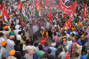 Indian leftist activists shout slogans as they burn an effigy of Indian Prime Minister Narendra Modi during a nationwide strike against the central government in Amritsar on September 2, 2015. Millions of workers across India held a 24-hour strike September 2 in protest at Modi's economic policies, which they say will put jobs at risk and hurt ordinary people.  Some 150 million workers, including those in the banking, manufacturing, construction and coal mining sectors, were expected to walk off the job.  AFP PHOTO/ NARINDER NANU