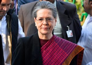 President of India's Congress Party Sonia Gandhi gestures as she arrives for a media briefing with Rahul Gandhi (L) inside All India Congress Committee (AICC) headquarters in New Delhi on December 19, 2015, after a court appearance by the pair.  An Indian court granted bail to opposition leaders Sonia and Rahul Gandhi minutes after they arrived at a Delhi court, over allegations they illegally acquired a newspaper's assets. . AFP PHOTO / CHANDAN KHANNA / AFP / Chandan Khanna