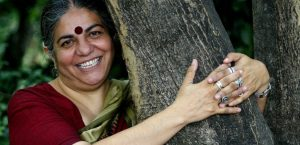Indian activist Vandana Shiva hugs a tree before giving a press conference for the first International Meeting for Friends of Trees in Barcelona, 22 June 2007. Shiva received the Right Livelihood Award, also known as the Alternative Nobel Prize, in 1993. / AFP / CESAR RANGEL
